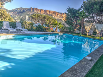 The private heated pool and garden, with views